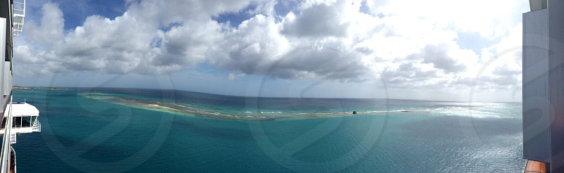 panoramic photography of ocean under white clouds photo