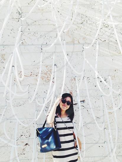 woman wearing a white and black striped cotton tshirt dress photo