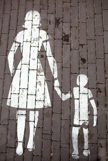 Road sign a mother and a child in Johvi Estonia. photo