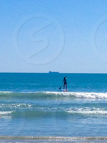 Paddle Boarder Heading to Sea photo