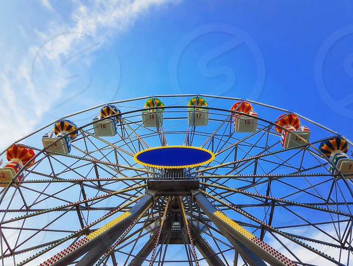 Close up view of a big ferris wheel above a deep blue sky background. photo