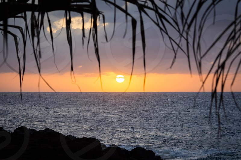 I took this photo on the north shore of Kauai at sunset right before we hiked back through the jungle to our car photo