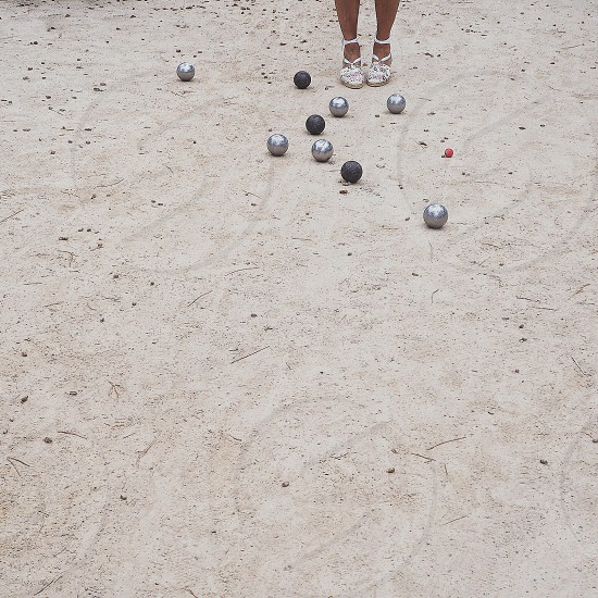 Pétanque balls game shoes France round round objects recreation minimal geometric shapes photo