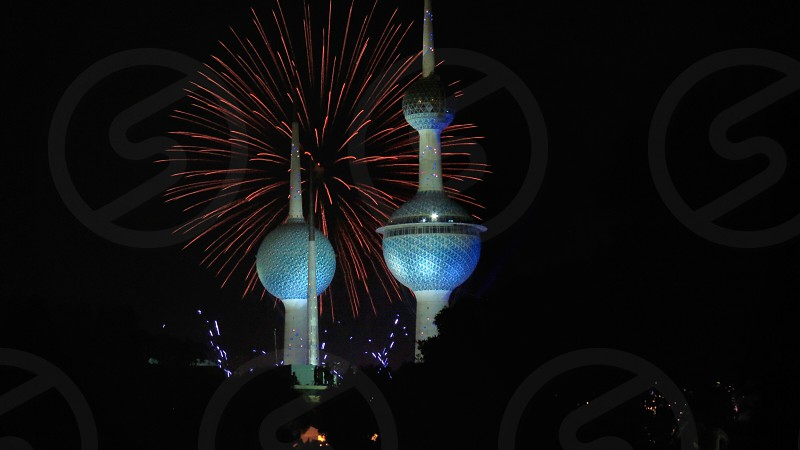 fireworks behind blue tower photo
