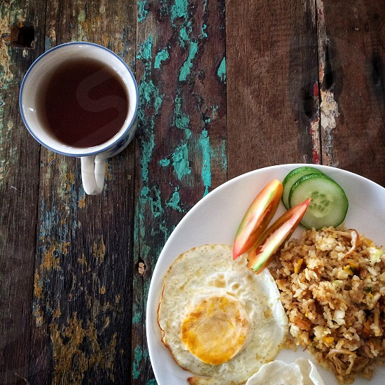 breakfast tea fried rice still life food. photo