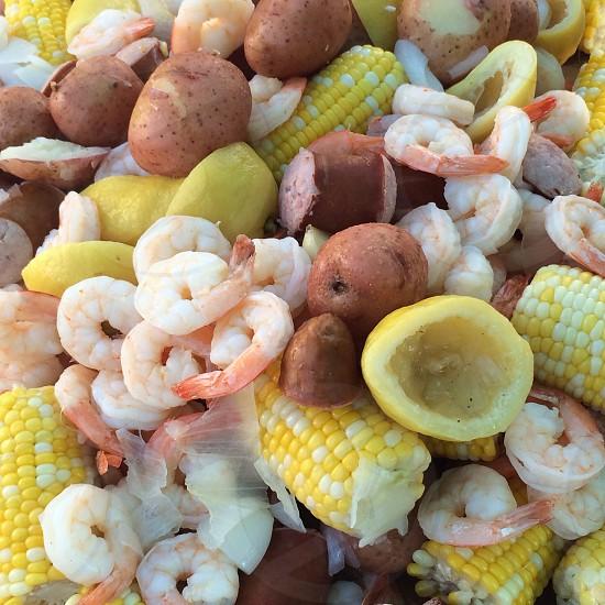 Shrimp Boil; corn; shrimp; lemon; sausage; onion; summer; food; picnic photo