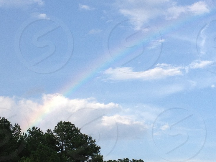 Rainbow in clearing sky photo