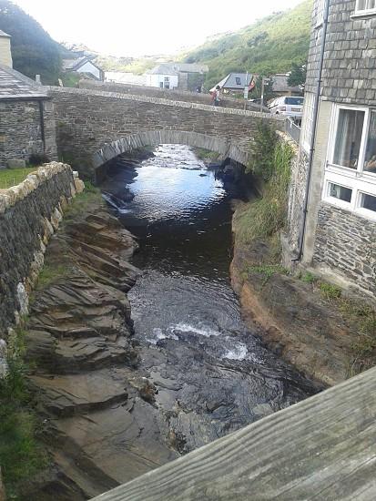 bridge cornwall river water brick rocks grass photo