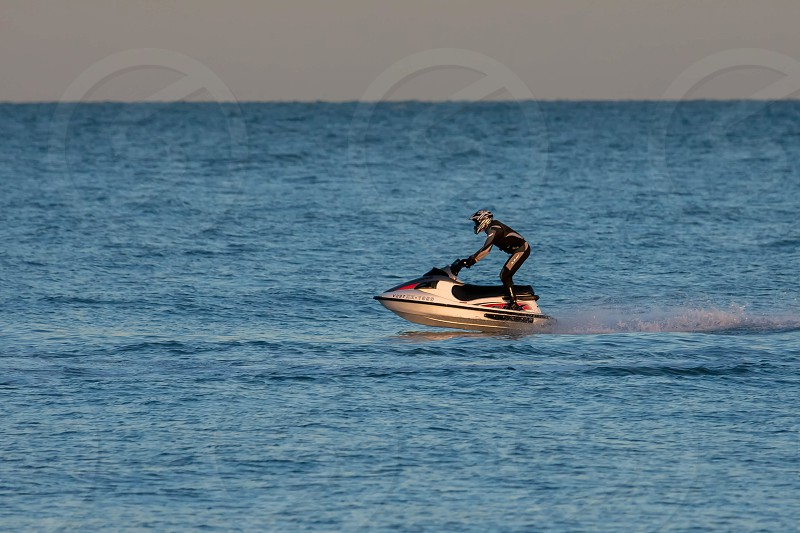 Man Riding a Jet Ski off Dungeness Beach photo