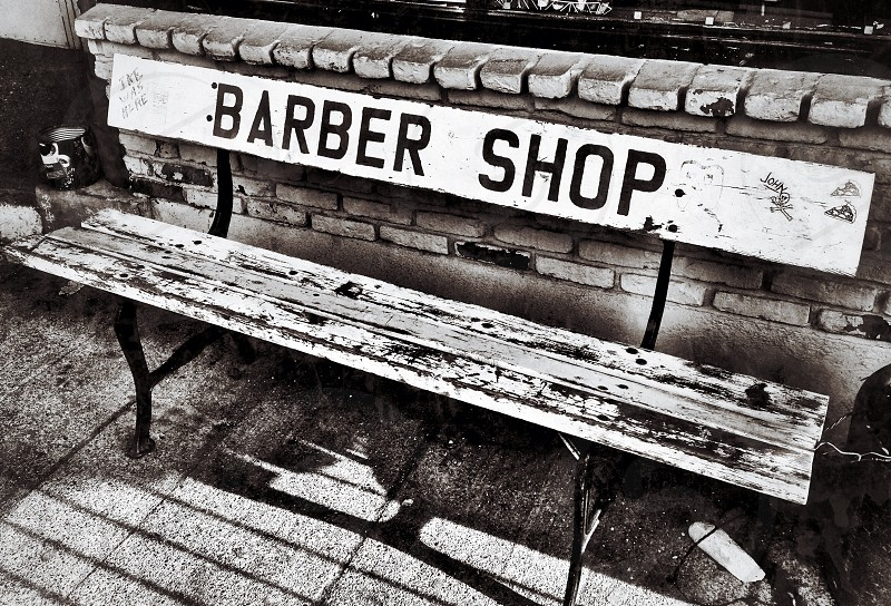barber shop sign on the bench photo