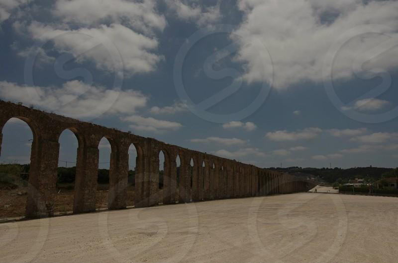 far view of combined pillars landmark at daylight photo