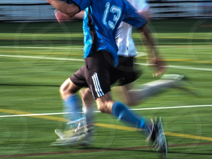 Motion captured in footrace to the goal photo