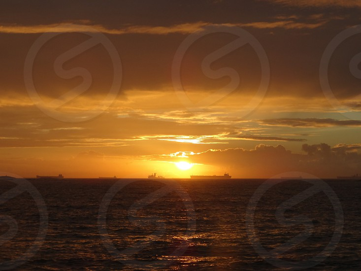 Ships sailing at the sunrises. Itapoã beach Brazil. photo