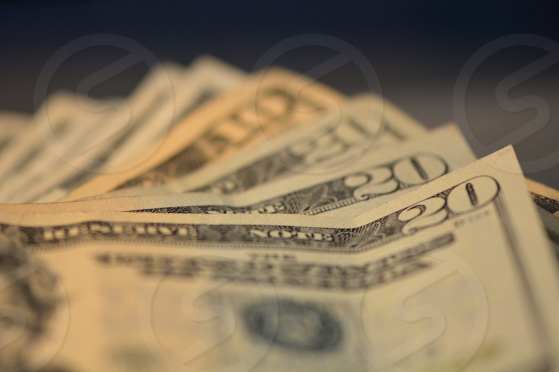 3 20 us dollar bills and one 10 us dollar bill photo