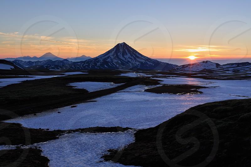 Volcanic landscape of Kamchatka: beautiful sunrise over Vilyuchinsky Volcano. Russia Far East Kamchatka Peninsula. photo