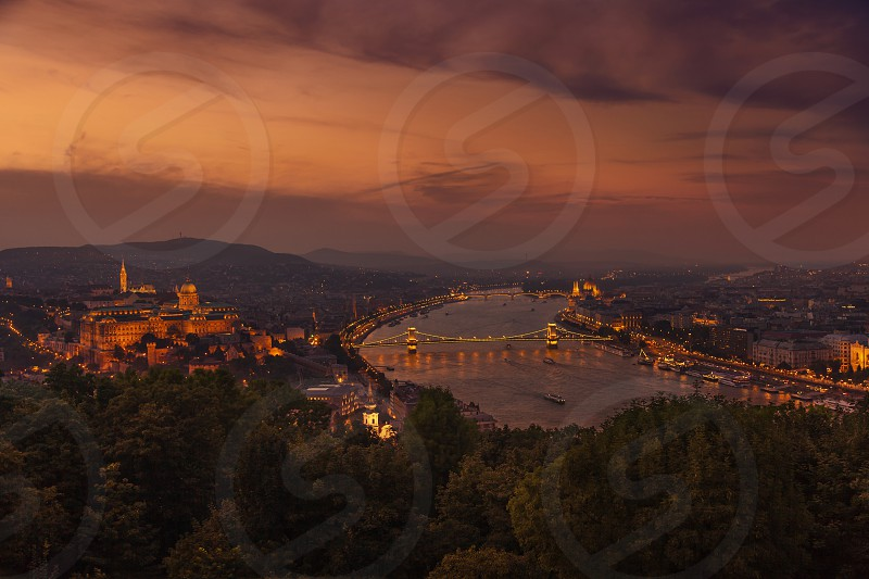 Panorama of the city at dusk with the Buda Castle on the hill and the Chain Bridge (Szechenyi Lanchid) and Margaret Bridge over the River Danube UNESCO World Heritage Site Budapest Hungary Europe photo
