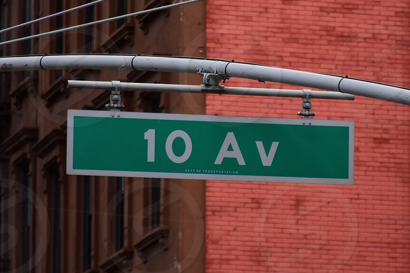 10 avenue highway signage during daytime photo