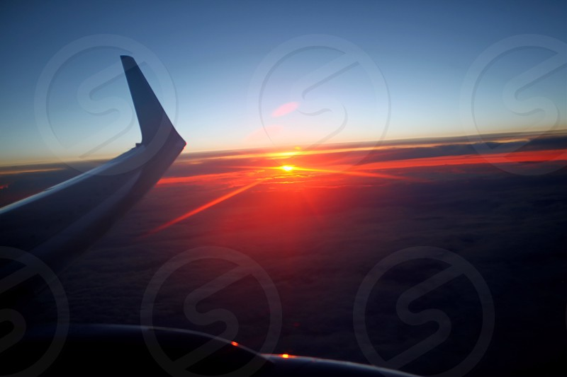 Sunset on a flight home from New York. photo
