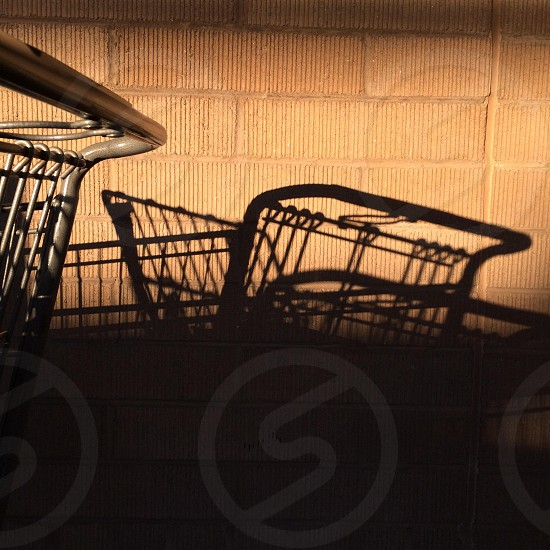Grocery shopping cart shadow consumerism store shop photo