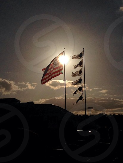 7 flags over GEORGIA SOUTHERN and sunset  photo