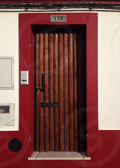 red door way with wood log door photo