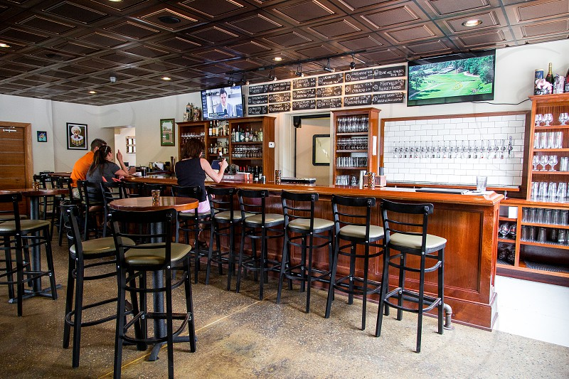 Interior of Maybank Public House with reclaimed wood rustic looks large beer tap wall and local spirit. photo