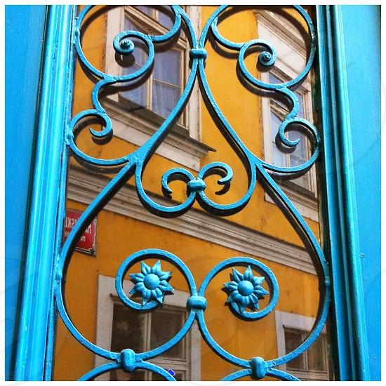 Reflected yellow facade in the window of a door photo