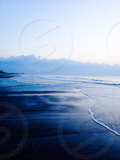 Beach nature waves calm peaceful calming cloudy cold winter bright dark sad sand photo