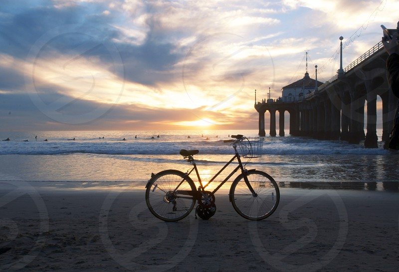 black road bike on the beach photo