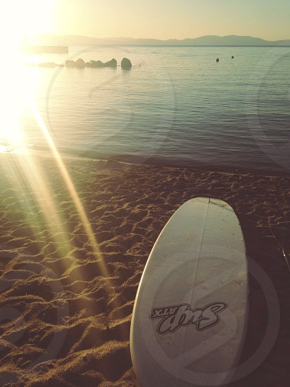 White surfboard on the beach photo