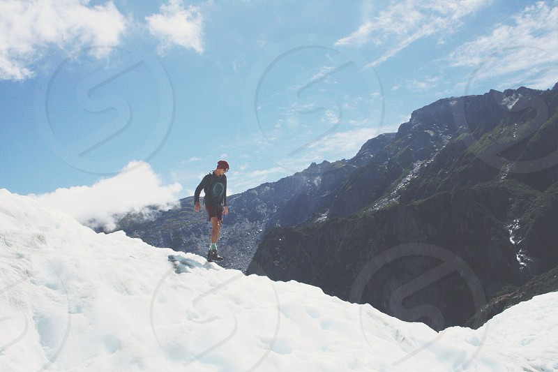 man  on top of mountain walking  photo