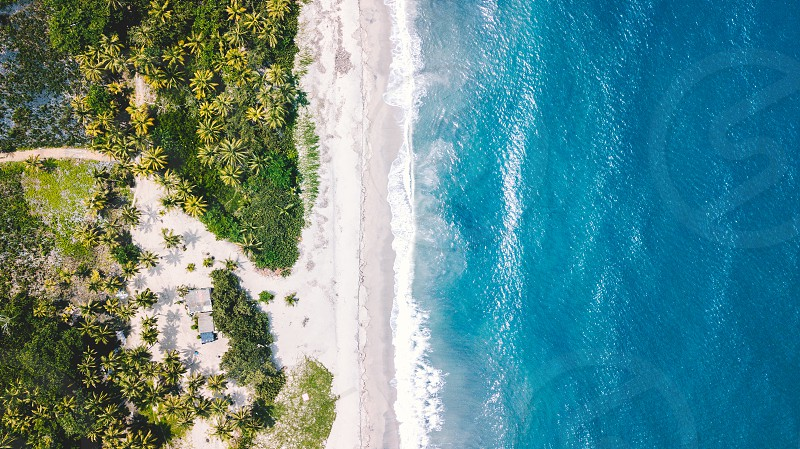 Aerial of a stunning blue and white sand beach on the Northern Coast of Colombia. photo