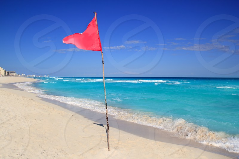 dangerous red flag in beach with rough sea signal photo