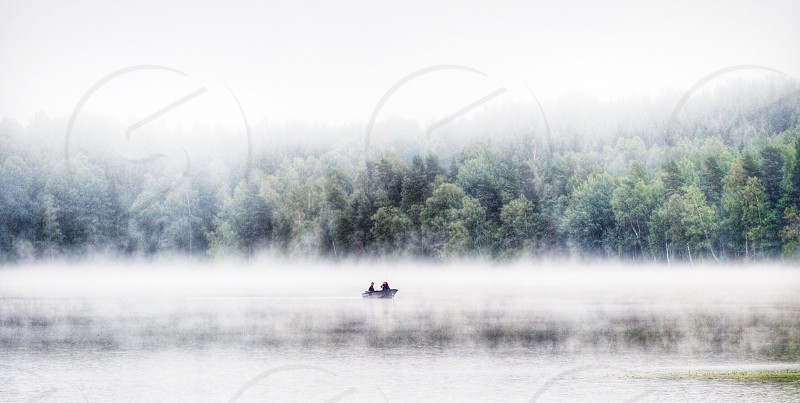 Foggy fog mist lake fishing fishers boat Sweden photo