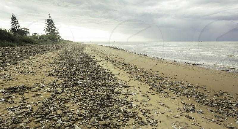 Pebble path along the seashore on the beach of Sanlucar de Barrameda Spain photo