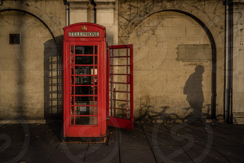 London telephone booth shadow photo