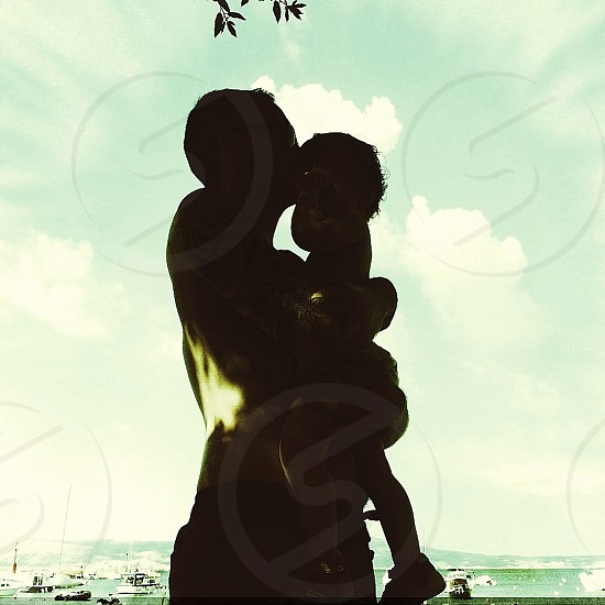 man and boy hugging silhouette  photo