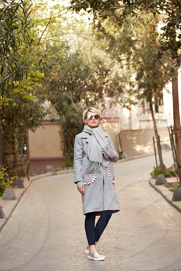Young blond woman with sunglases on the street. photo