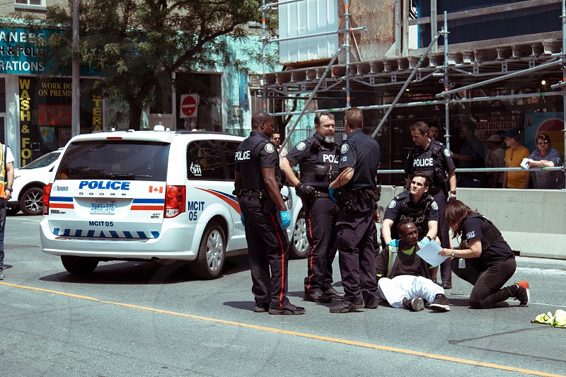 Police justice prison people hopes dreams streets Toronto love peace war  photo