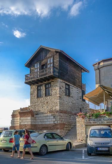 Nesebar Bulgaria – 07.09.2019. Old house on the promenade of Nesebar Bulgaria on a sunny summer day photo
