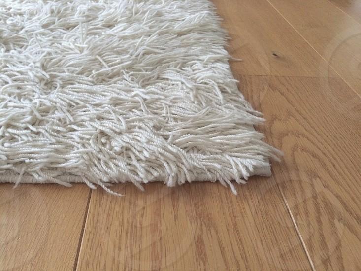 Textile on wood floor photo