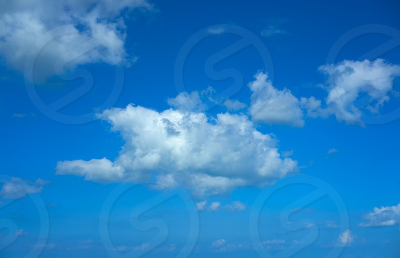 Blue sky summer white cumulus clouds background photo