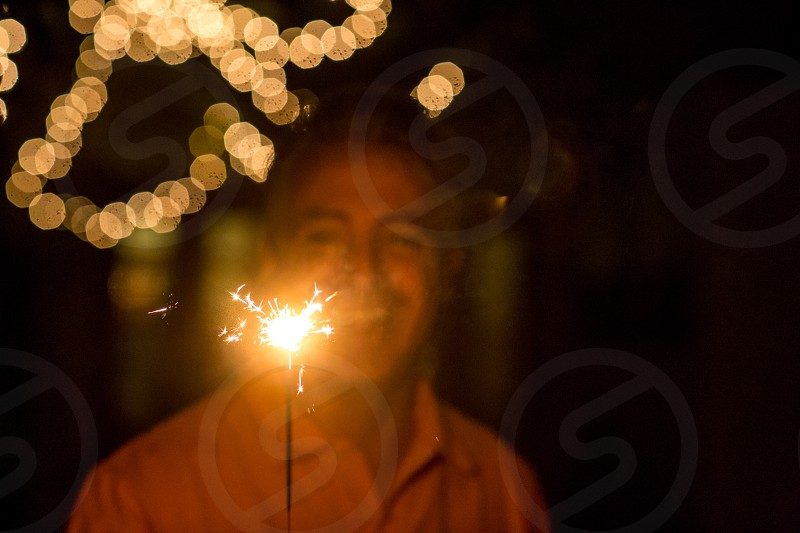 Man holding a sparkler at night  photo
