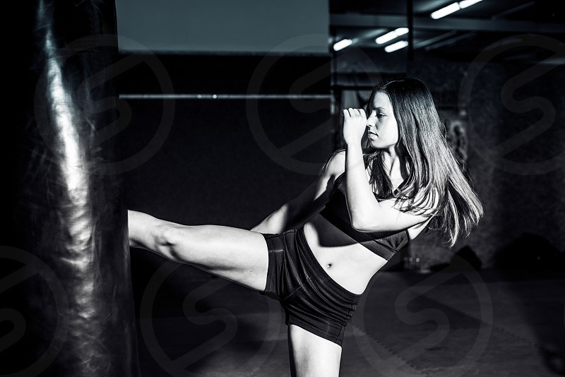 Young girl training kickboxing in the gym. photo