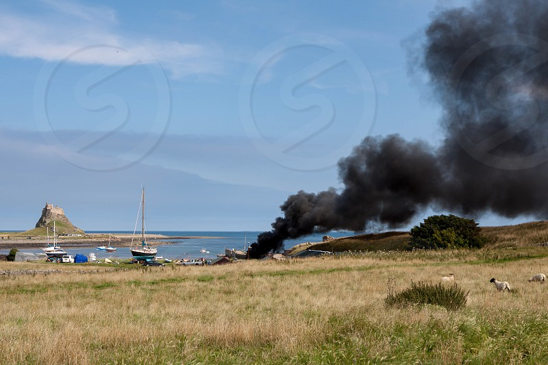 Fire on Holy Island of Lindisfarne Northumberland photo