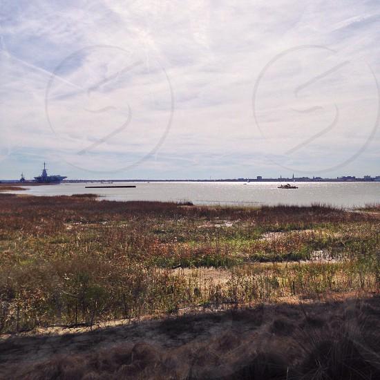 green grass field an ocean photograph photo