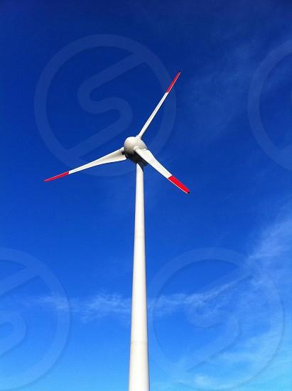 windmill on a clear blue sky photo