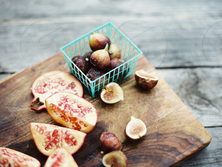 sliced fig fruit on brown wooden cutting board photo