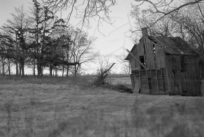 old dilapidated barn in black and white photo