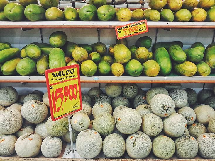 melon papaya at farmers market photo